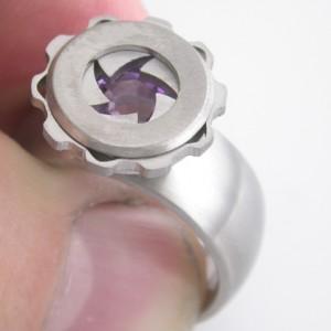 The Iris ring has a working mechanical shutter mechanism which reveals a hidden stone.