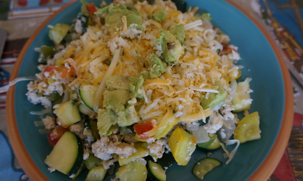 I like to top my egg scrambles with either avocado or cheese or both!