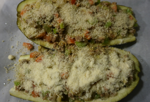 The stuffed eggplant prior to baking in the oven. Only the half on the bottom is sprinkled with parmesan cheese.