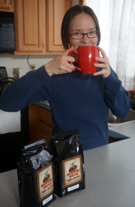 Christy drinking strong Ethiopian coffee!
